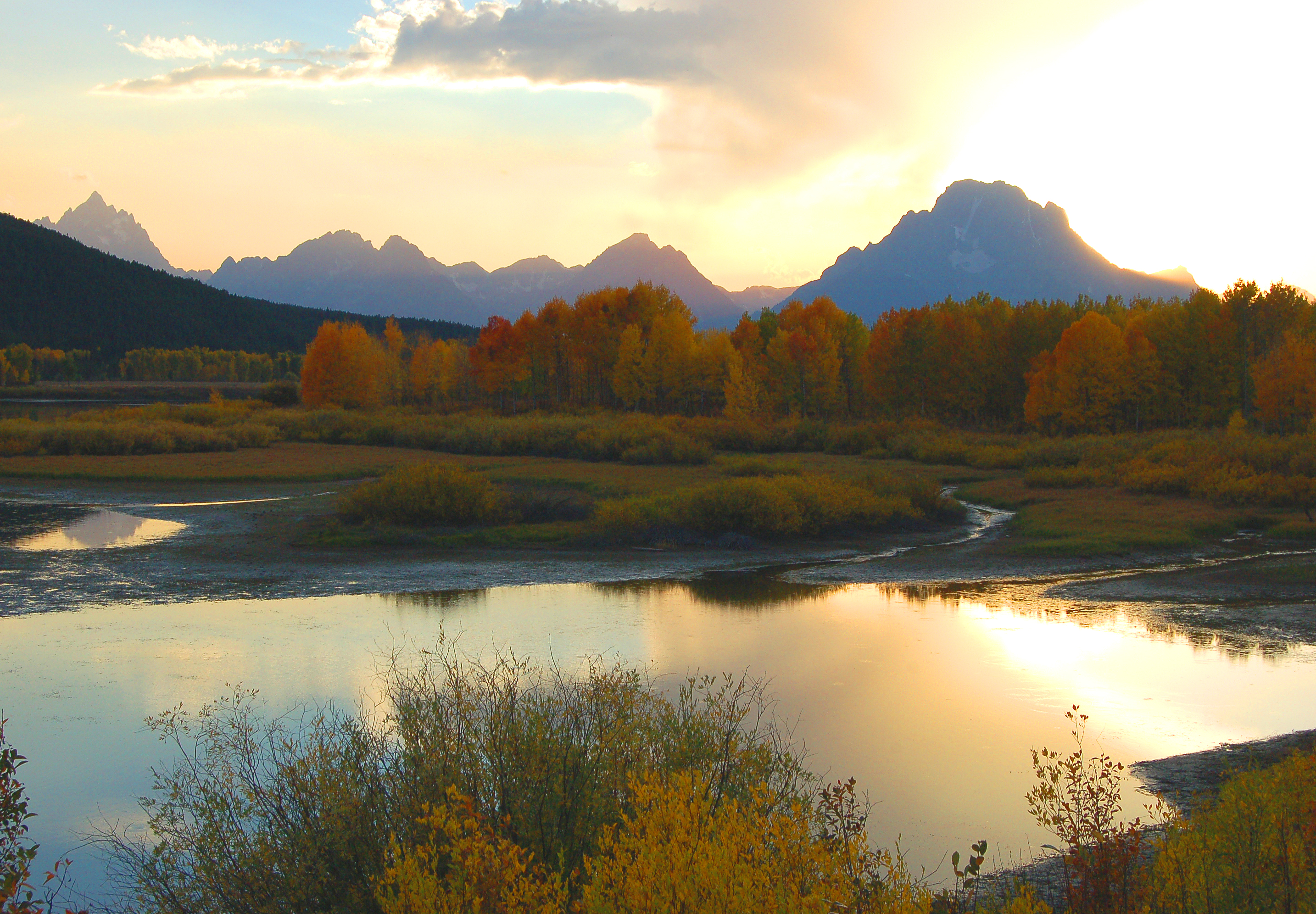 Another shot at sunset... in the Tetons.... in the fall..... There was a huge bull moose across the river, but all the photographers had their cameras pointing towards the sunset.